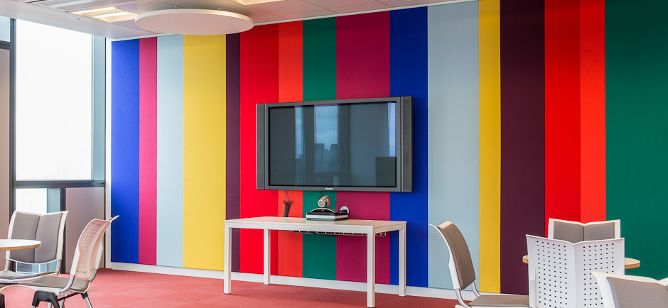 multicoloured stretched acoustic fabric wall in telepresence room