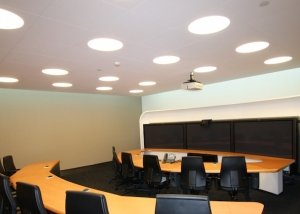 Full acoustic wall wrapped in fabric in corporate video conferencing room