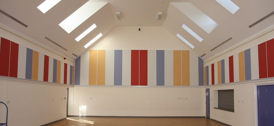 Super g acoustic wall panels, printed in various colours, seen on sports hall wall