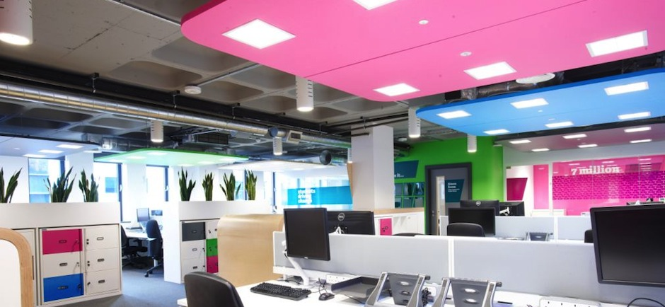 open plan office with bright ceiling panels