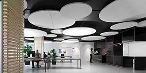 Office featuring circular acoustic panels on the ceiling.