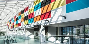 Multi coloured acoustic wall panels in a shopping centre