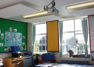 school classroom with white sound absorbing panels hanging from ceiiling
