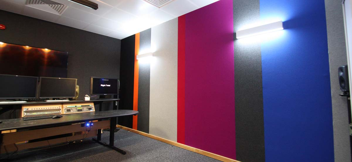 Multicoloured fabric sound absorbing wall panels in Sky's editing suites