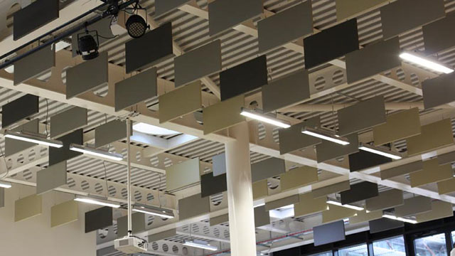 acoustic baffles suspended from school hall ceiling