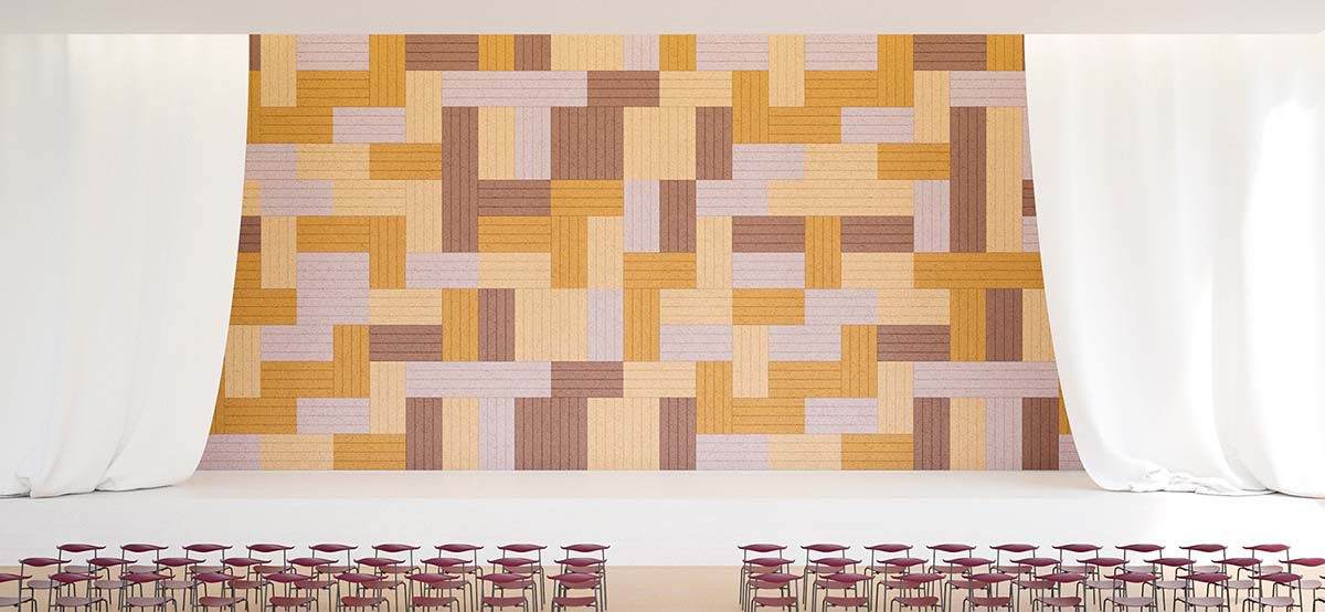 Patterned sound absorbing wall tiles on auditorium wall