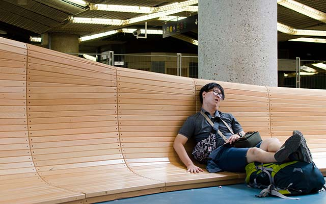 Traveller sleeping in exhaustion