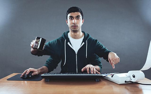 Man multitasking at desk
