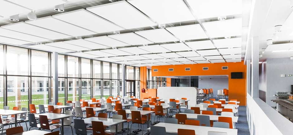 Canteen with acoustic treatment on ceiling.