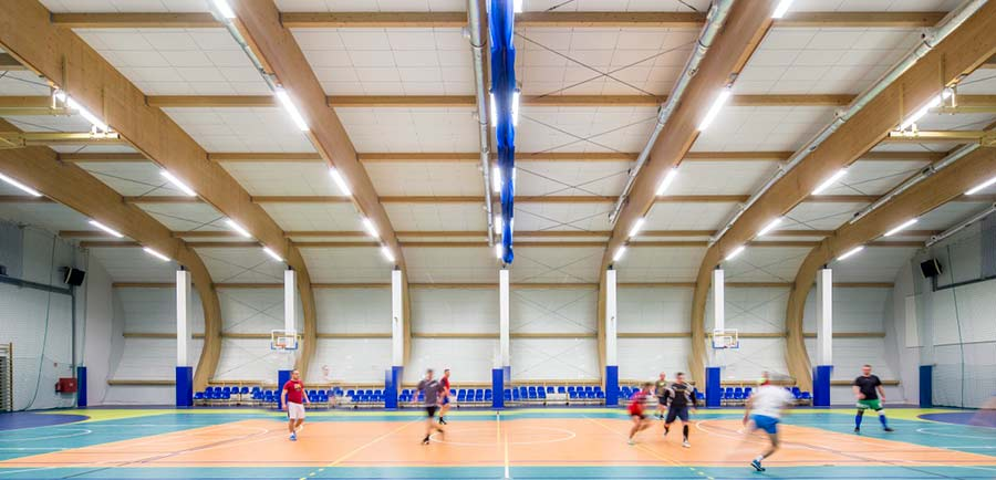 grey sound absorbing panels in school sports hall