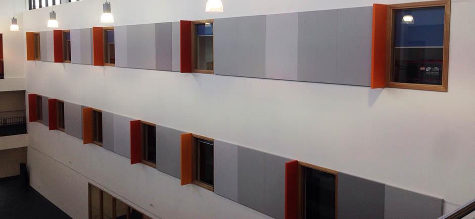 wall panels absorbing sound in school corridor