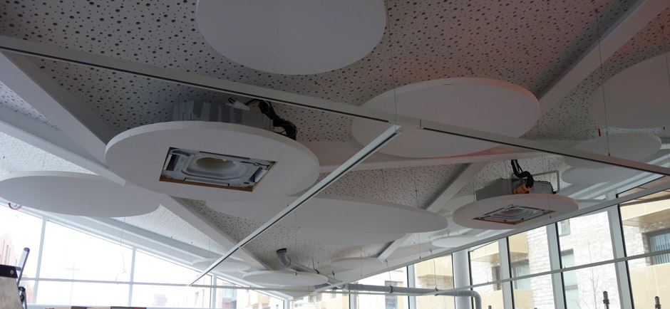 cafe ceiling with acoustic panels in london