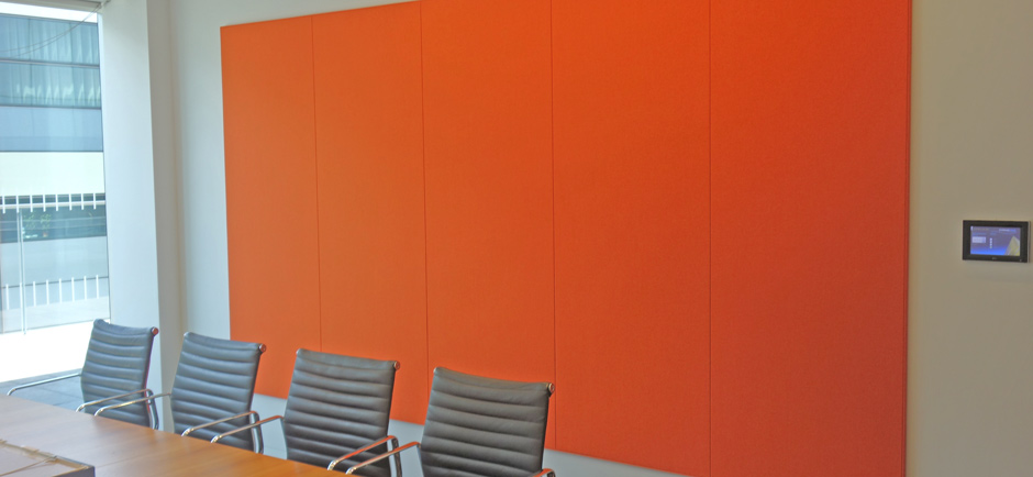 orange acoustic wall panels in boardroom