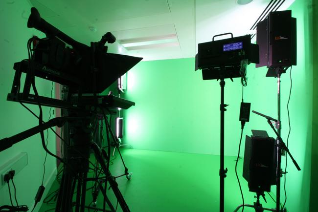 green fabric wall in recording studio