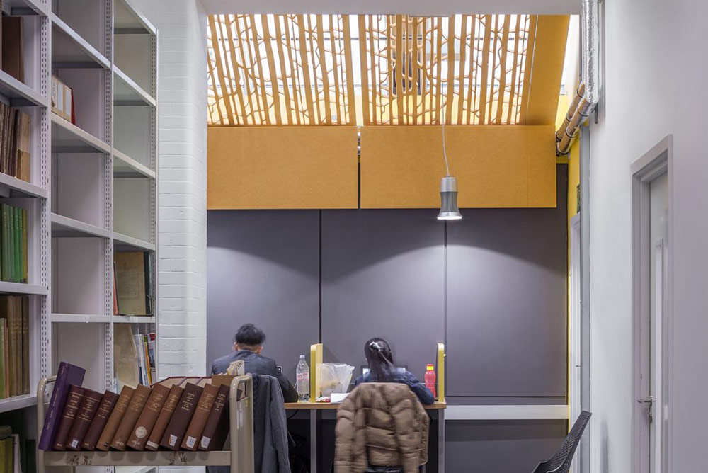 yellow acoustic screens in library